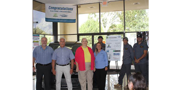 (Photo courtesy of Hollee Photographee) (Left to right) Eric Tomkiewicz, GEICO area district manager central New Jersey, Paul Branning, owner of Branning Collision Centers, Mary, vehicle recipient, Kim Branning, and Branning Collision technicians.