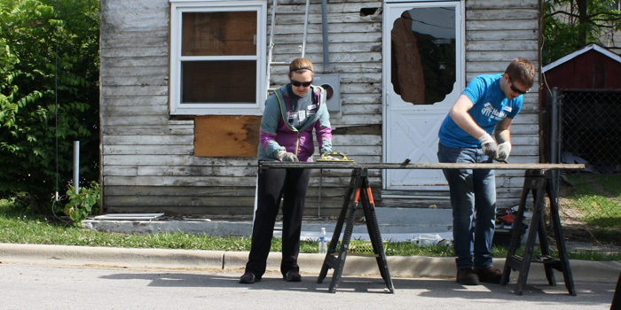 Jenna Machunas and Darian Smith of VSG work at the build site on Wednesday morning.