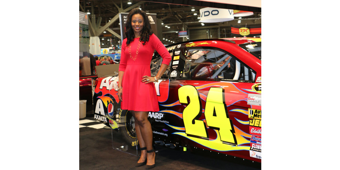 Lisa Miree-Luke with No. 24 Axalta Chevrolet SS painted in Radiant Red.