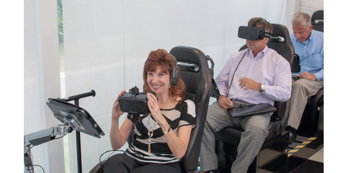 Editors tried on the technology for themselves during the demonstration. Photo credit: Babcox Media/Mel Sayre.