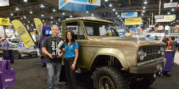 Richard Gochanour with Shefali Cromer, BASF Glasurit market segment manager, in front of the Bronco.