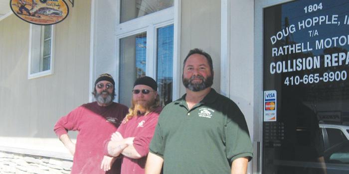From left: Ron Wisniewski, bodyman, Doug Clayton, painter, and Doug Hopple, owner.