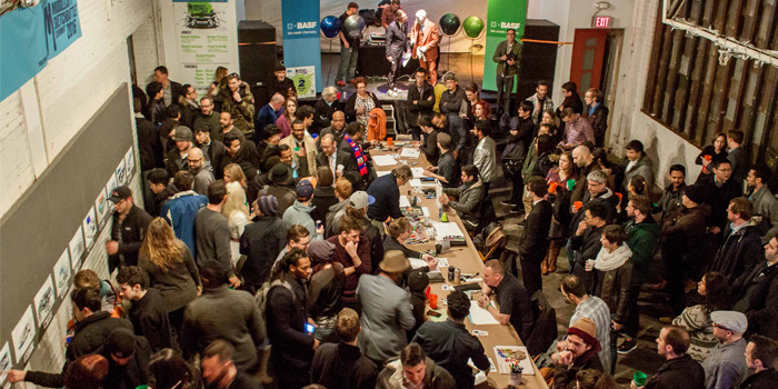 The 14 design competitors sketch at a table surrounded by hundreds of onlookers during the 2016 Middlecott Sketchbattle presented by BASF.