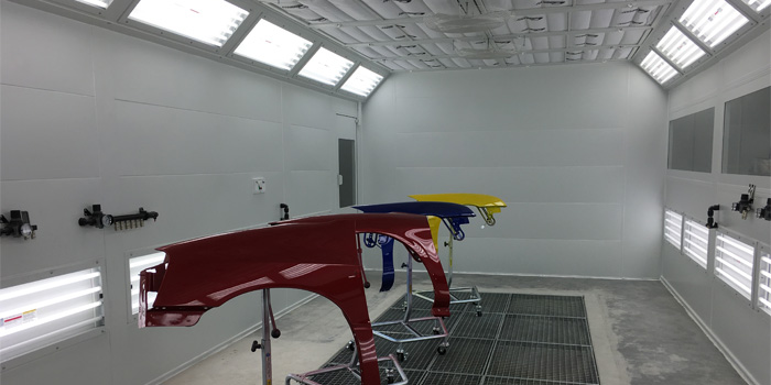 3000 Series Spray Booth at the Center. It has superior airflow and the most effective lighting in any booth available in the market today.
