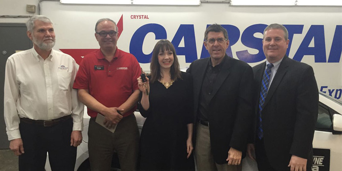 Pictured from left to right: Walt Jost, Farmers; MJ Alaga, general manager of Crystal Carstar; Aubree Ridley, Safe Home Kansas; Dan Young, president of CARSTAR; and Mike Boehm, mayor of Lenexa, Kan.