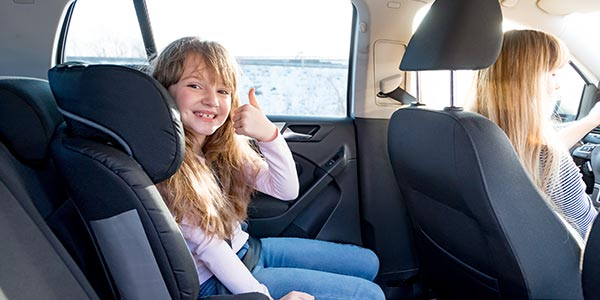 This image has an empty alt attribute; its file name is child-in-car-seat.jpg
